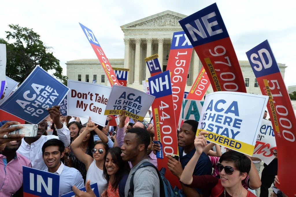 Supporters of the Affordable Care Act celebrate a 6-3 Supreme Court ruling upholding all provisions of the health care law on June 25, 2015. (Photo: Pat Benic/UPI/Newscom)
