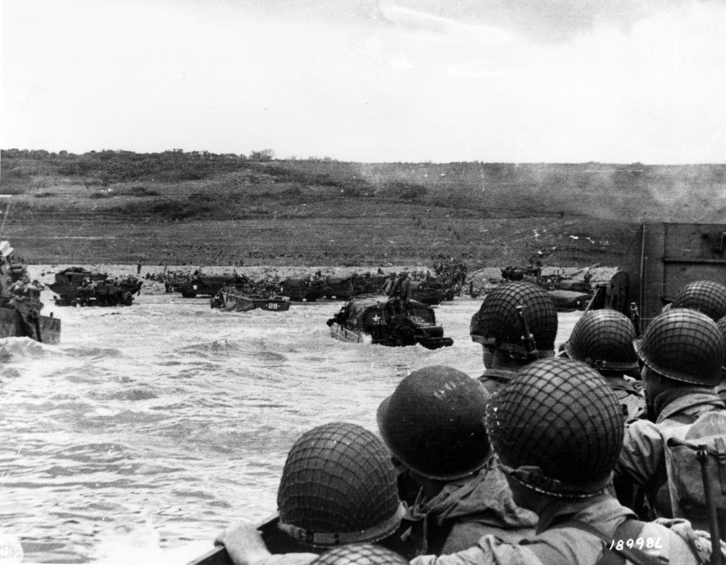 Troops watch activity ashore on Omaha Beach as their LCVP landing craft approaches the shore on D-Day, June 6, 1944, during the Allied invasion of German-occupied France. (Photo: U.S. Army Signal Corps/National Archives/UPI/Newscom)