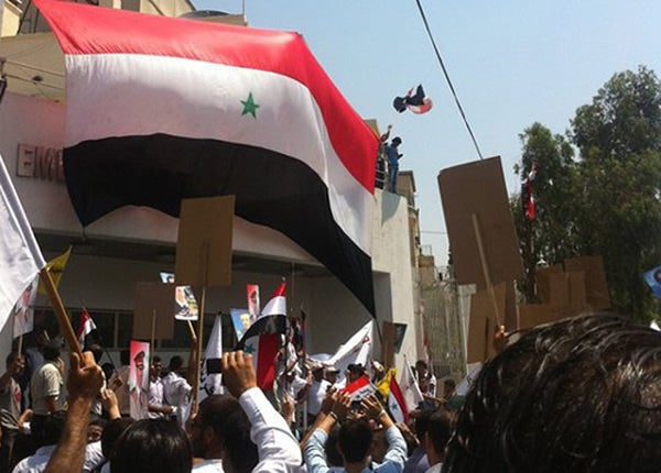 Pro-Syrian-government protesters gather outside the US Embassy in Damascus