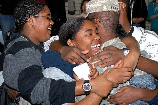 Sgt. 1st Class Danny J. Hocker, is embraced by his family during a welcome home ceremony in Vilseck, Germany, Oct. 23, 2008. He returned to Germany after a 15-month deployment in support of Operation Iraqi Freedom. (Photo: US Army Photo by SPC Pastora Y. Hall/Released)