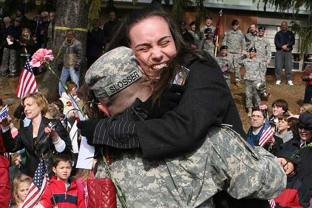 Kira Slosser gives her brother Army Sgt. John Slosser a warm welcome home hug Feb. 21. He returned home after eight months serving in Iraq. (Photo: Maj. Cotton Puryear, Virginia Guard Public Affairs)