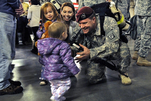 Staff Sgt. Michael Bernquist, holds his arms out for his daughter Evelyn, 1, after returning from a 12 month deployment to Iraq at Fort Bragg, N.C., Nov. 4, 2010. Bernquist was also greeted by his wife, Brandi, and older daughter Brooke, 4. (Photo: US Army Flickr)