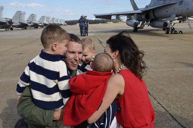 Lt. Cmdr. Nate Lyon is reunited with his wife and children during a homecoming celebration for the squadron in 2012  after a six month deployment supporting Operation Enduring Freedom, maritime security operations and theater security cooperation efforts. (Photo: U.S. Navy photo by Mass Communication Specialist 2nd Class Antonio P. Turretto Ramos/Released)