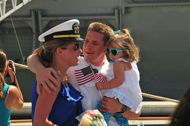 Lt. Andrew Wood is greeted by his wife daughter during a homecoming celebration as he returns from a seven-month deployment in 2013. Wood was deployed to support the United States Africa Command counter-terrorism, intelligence and reconnaissance missions. (Photo: U.S. Navy photo by Mass Communication Specialist 1st Class Ian W. Anderson/Released)