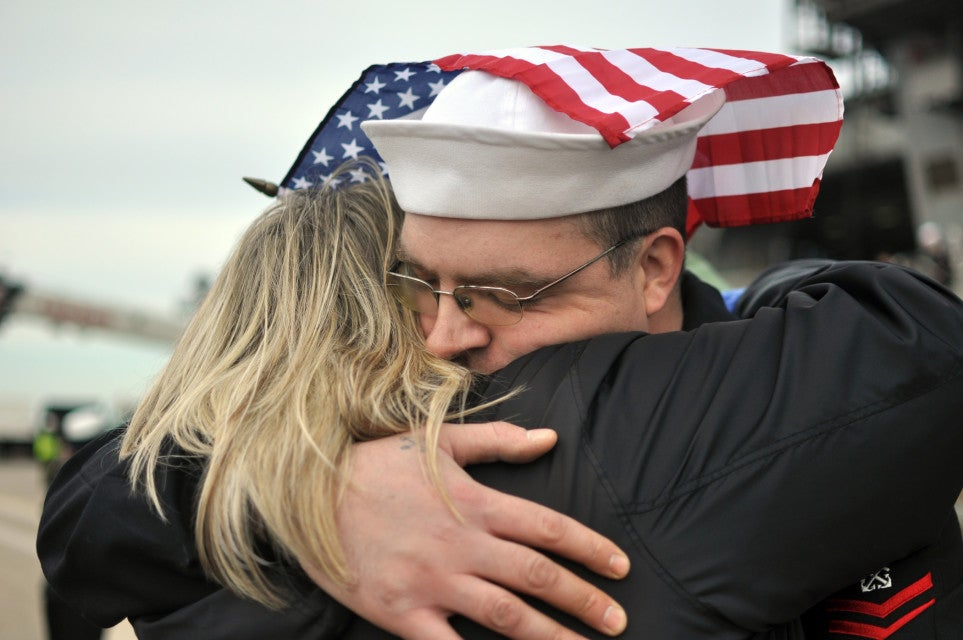 Boatswain's Mate 2nd Class Anthony Gitar, assigned to the aircraft carrier USS George H.W. Bush (CVN 77), hugs his wife, Lori, following the ship's return to Naval Station Norfolk. George H.W. Bush completed its first combat deployment in support of Operations Enduring Freedom and New Dawn. (U.S. Navy photo by Mass Communication Specialist 2nd Class Timothy Walter/Released)