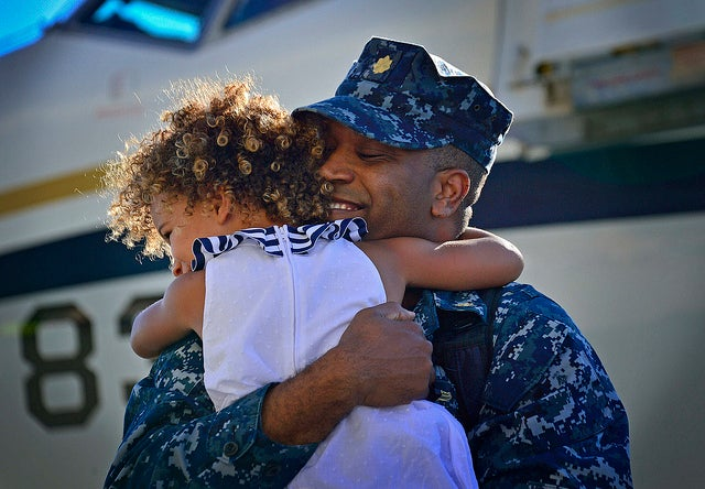 U.S. Navy Lt. Cmdr. Charles Harris embraces his daughter during a homecoming celebration at Naval Air Station North Island, San Diego, Calif., Aug. 7, 2013. (Photo: DoD photo by Mass Communication Specialist 2nd Class Daniel M. Young, U.S. Navy/Released)