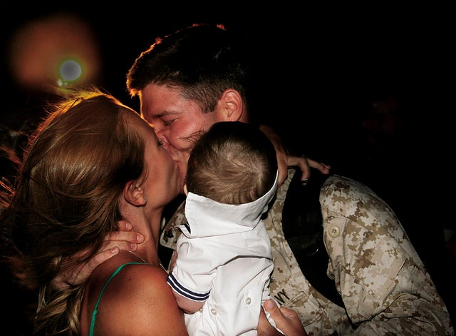 Navy Petty Officer Second Class Mitch T. Embry, corpsman, 1st Battalion, 3rd Marines, greets his wife after returning from a seven-month deployment to Afghanistan in support of Operation Enduring Freedom June 9, 2010. (Photo: United States Marine Corps Flickr)