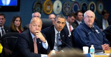 "Homeland Security Secretary Jeh Johnson, pictured with President Barack Obama and Federal Emergency Management Agency Administrator Craig Fugate, says there are ""legal limits"" for reviewing social media of foreigners looking to enter the U.S. (Photo: Pete Souza/ZUMA Press/Newscom)"