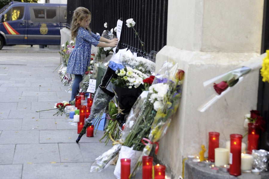 Spanish citizens of all ages place flowers and candles outside the French embassy in Madrid, Spain. (Photo: DyD Fotografos/Newscom)