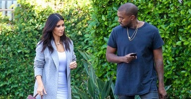 Kim Kardashian and Kanye West head to the Kardashians' office in Los Angeles. Kim's net worth is around $65 million. (Photo: Newscom)