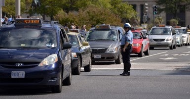 Taxis attend a strike and demonstration protesting against new rules that will allow app-based services such as UberX, Lyft and Sidecar to operate in D.C. (Photo: Xinhua/Yin Bogu/Newscom)