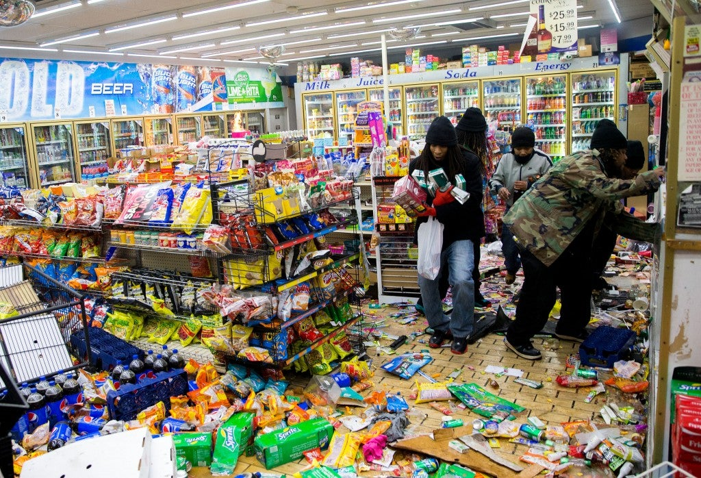 Inside a local convenience store as the looting begins. (Photo: Xinhua/Ting Shen/Newscom)