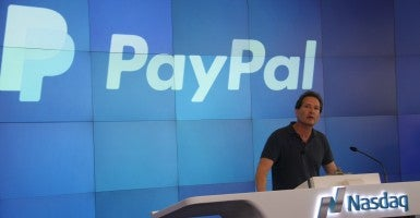 PayPal President and CEO Dan Schulman speaks in July 2015 at Nasdaq in New York.  His company does business in countries where homosexuality can result in a death sentence, but opposes religious liberty laws in America. (Photo: Huang Jihui Xinhua News Agency/Newscom)