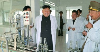 North Korean leader Kim Jong Un tours a liquor factory in North Pyongan Province. (Photo: Newscom)