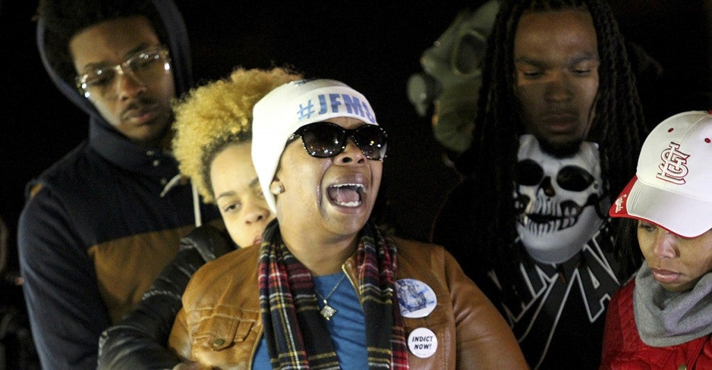 Michael Brown's mother, cries after learning of a grand jury's decision to not indict police officer Darren Wilson. (Photo: Timothy Tai/Newscom)