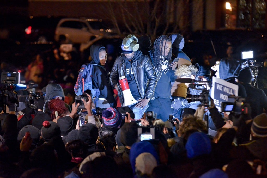 A group of protesters lead the gathering before the Ferguson police department. (Photo: Richard Ulreich/Newscom)