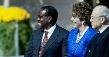 """""""I have every faith that you will be the beacon of light for others to follow, that city on a hill that cannot be hidden,"""" Supreme Court Justice Clarence Thomas said at a Hillsdale College commencement speech. (Photo: Mark Reinstein/ZUMA Press/Newscom)"""