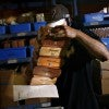 In the shipping and packing department, Daniel Matos, 32, pulls cigar boxes off the she