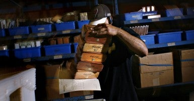 In the shipping and packing department, Daniel Matos, 32, pulls cigar boxes off the shelves to fill orders at the J.C. Newman Cigar Co. (Photo: St. Petersburg Times/ZUMAPRESS.com)