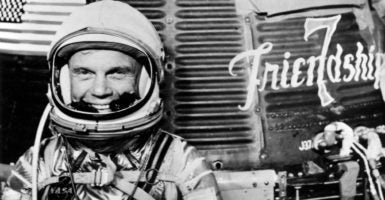 A 1962 photo of John Glenn with the Mercury ''Friendship 7'' spacecraft during preflight activities.(Photo: Atlas Archive/Nasa/ZUMA Press/Newscom)