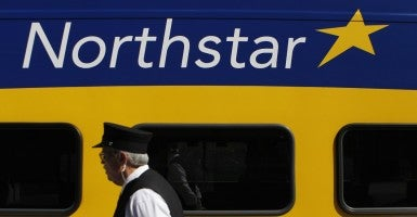 Conductor J.R. Long walks by the Northstar Commuter Rail in Minneapolis, Minn. (Photo: Carlos Gonzalez/Zuma Press/Newscom)
