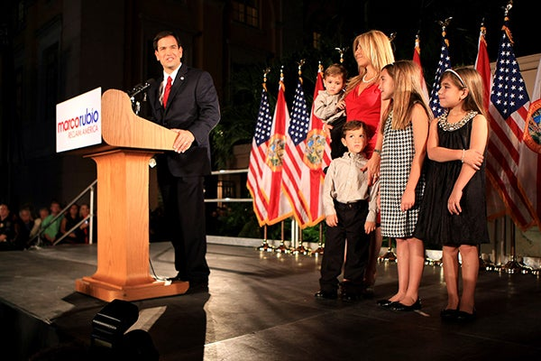 Marco Rubio celebrates a 2010 victory. Dominick, his youngest, sits in Jeanette's arms. (Photo: Mike Stocker/Sun-Sentinel/Newscom)
