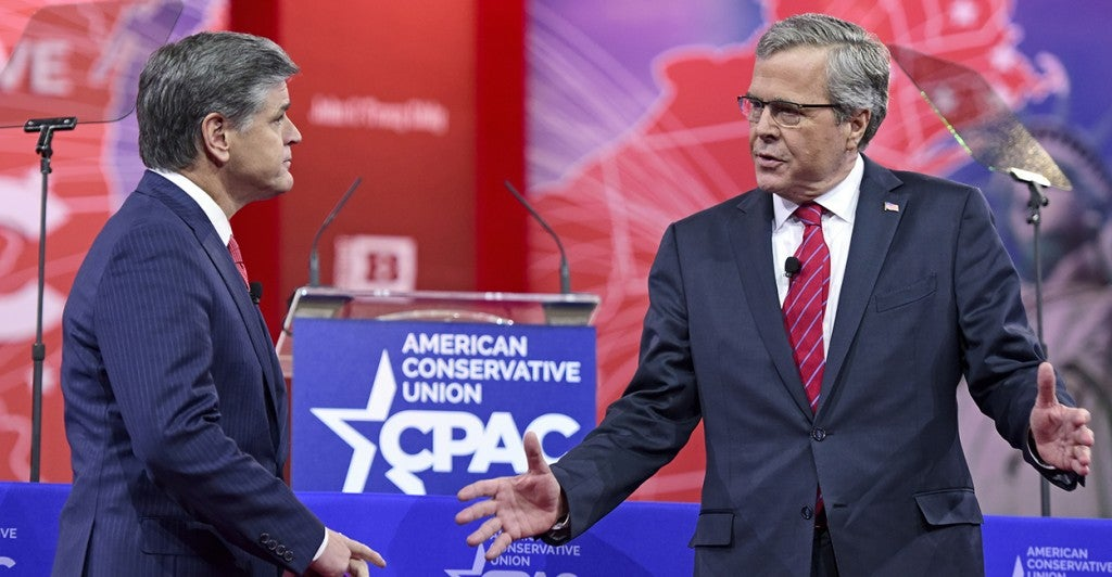 Jeb Bush fields questions from Fox News host Sean Hannity at CPAC. (Photo: Ron Sachs/Newscom)