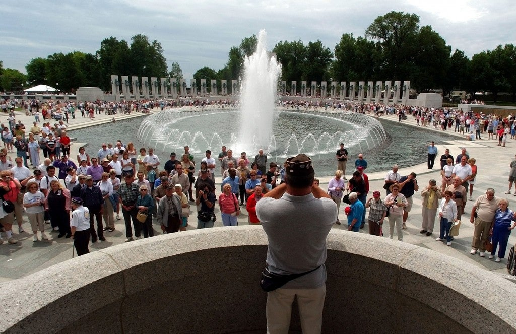 Ross E. Medos with Bugles Across America, makes in impromptu playing of Taps Friday, May 28, 2004 at the World War II Memorial in Washington D.C. ''It's just something I needed to do, '' he said. (Photo: Bahram Mark Sobhani/San Antonio Express-News/Newscom)