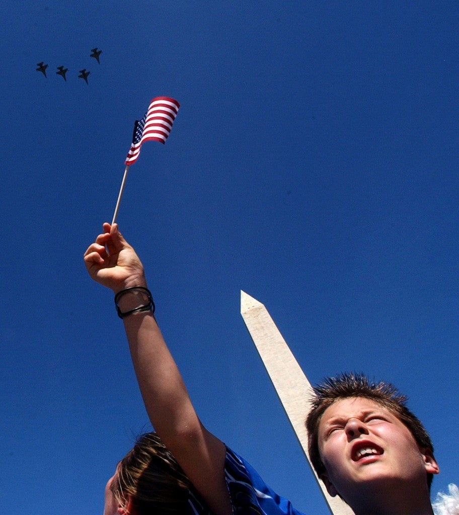 An Air Force flyover helps conclude the World War II Memorial dedication ceremony in 2004. (Photo: Bahram Mark Sobhani/San Antonio Express-News/Newscom)