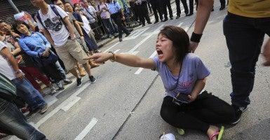 A pro-democracy protester in the Mongkok district of Hong Kong. (Photo: Guillaume Payen/NurPhoto/Newscom)