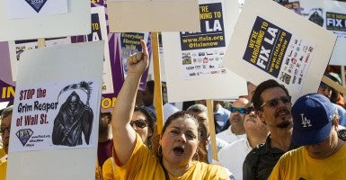 Members of the Fix LA coalition take part in a march and rally in downtown Los Angeles. The Fix LA coalition, as they describe themselves, wants to institute a $15 minimum wage. (Photo: Ringo Chiu/ZUMA Wire/Newscom)