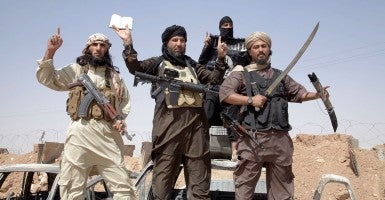 Fighters from the ISIS terrorism group (Photo: Newscom)