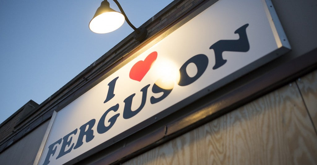 Community members had to board up their 'I Heart Ferguson' shop that fundraised for businesses that have been victims of looting and vandalism. (Photo: Zach D. Roberts/Newscom)