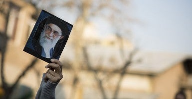 An Iranian demonstrator holds-up a portrait of Iran Supreme Leader Ali Khamenei during a demonstration in Tehran. (Photo: Morteza Nikoubazl/Newscom)