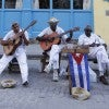Musicians perform on a street in the Habana