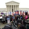 People protest outside the U.S. Supreme Court on the morning of oral arguments in King v. Burwell, a challenge to the Affordable Care Act. (Photo: Brian Cahn/ZUMA Press/News