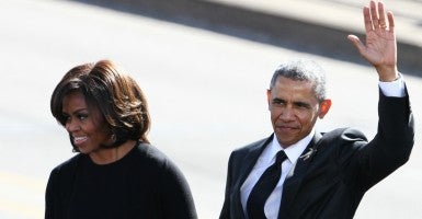 First Lady Michelle Obama and President Barack Obama wave before speaking in Selma. (Dan Anderson/ZUMA Press/Newscom)