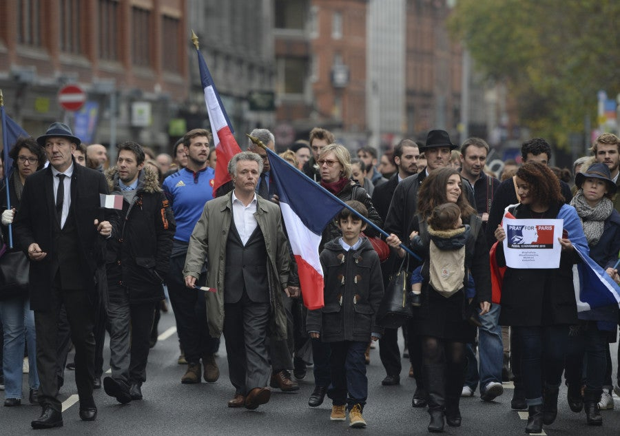 "French and Irish join together during a ""March in Solidarity with Paris"" in Dublin's city center, Saturday. (Photo: Artur Widak/ZUMA Press/Newscom)"