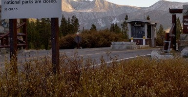 A sign placed at the eastern entrance to Yosemite National Park along Highway 120 alerts visitors of the park closure due to the federal government shutdown in 2013. Congress is now trying to grab more U.S. land for the government. (Photo: Newscom)