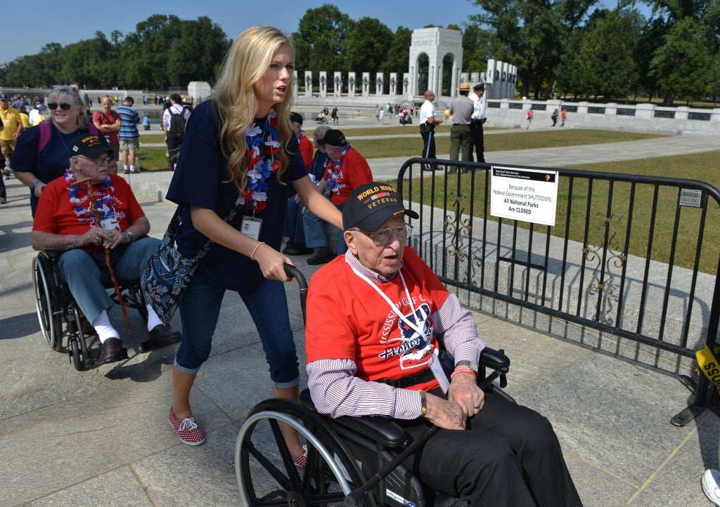 War II veterans flown in to visit their memorial stormed the barriers at the World War II Memorial on the first day of a federal government shutdown in 2013. The memorial was initially closed, but reportedly forced opened by the veterans. (Photo:  Jay Mallin/Newscom)