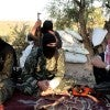Members of the An-Nusra Front, which cooperates with Khorasan in Syria. (Photo: Newscom)
