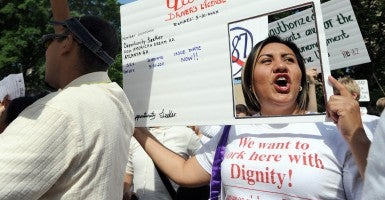 "An Arizona policy barring ""DREAMers"" from getting state drivers' licenses was struck down by a federal court Thursday. (Photo: Erik Lesser/ZUMAPRESS.com/Newscom)"